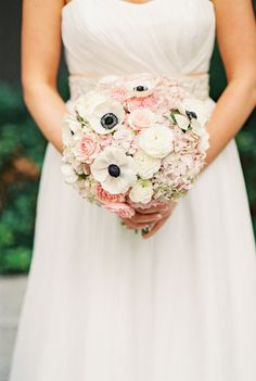 Anemones alway POP in a bouquet | From SMP:   http://www.stylemepretty.com/oregon-weddings/portland/2013/11/25/portland-oregon-wedding-at-the-benson-from-brittany-lauren-photography | Brittany Lauren Photography