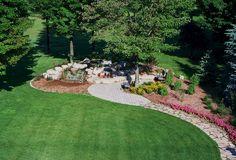 Garten-Landschaftsbau Gartensitzgruppe Tor entspannt mit der Spitze des Gartens im Schloss und das Schneiden des Gartens selbst