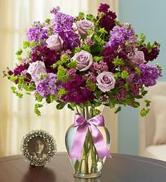 Shades of Purple™ Our luxurious, all-pink arrangement is the sweetest way to express how you feel. Fresh roses, lilies and more are artistically hand-arranged inside a textured pink vase for feminine
