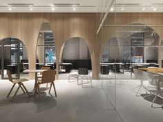 "Wooden partitions with arch-shaped cutouts are used to separate the workspaces from an indoor ""courtyard"" inside fashion brand H&M'slogistics office in Taiwan. The office on the outskirts of Taipei. Corporate Interiors, Office Interiors, Corporate Offices, Contemporary Interior Design, Office Interior Design, Cheap Furniture, Office Furniture, Wooden Furniture, Furniture Nyc"