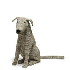 Recycled Dogs - The perfect pet. Each cheerful canine is fashioned from twisted and woven newspaper and sports a wooden nose and eyes. These paper pooches are so friendly that their newspaper tails almost wag. No walks or house training required.