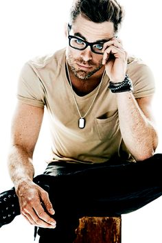 Chris Pine - where to look first, the arms or the glasses and those eyes. I would say eyes x