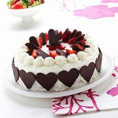 Per una ricorrenza romantica, ecco una torta a forma di cuore decorata a mano