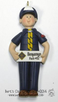 Basic Cub Scout Ornament by BertsClayCreations on Etsy (Art & Collectibles, Sculpture, Figurines, polymer clay, clay ornaments, childrens ornaments, personalized, engraved ornaments, holiday ornaments, sculpture, polymerclay ornament, Scouting, boy scout, cub scouts, weeblos ornament, bear scouts)