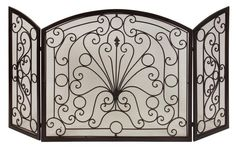 "Fire Screen - Simple elegance blends with functionality in this beautiful wrought iron fireplace screen. Material: Wrought iron 100%. 32.5""h x 63""w."
