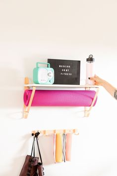 Try These Brilliant Home Gym Hacks in Your Tiny Apartment - Brit + Co - Towel Home Yoga Room, Workout Room Home, Gym Room At Home, Home Gym Decor, Workout Rooms, Mini Gym, Home Gym Garage, Home Gym Design, Tiny Apartments