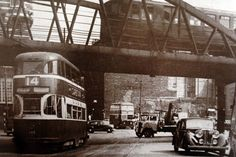 A double-decker bus crosses paths with Liverpool's Overhead Railroad. Liverpool Docks, Liverpool History, Old Pictures, Old Photos, Double Decker Bus, Air Raid, Abandoned Places, How To Memorize Things, Travel