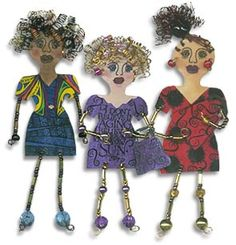 Shrink plastic dolls with wire hair and beaded arms and legs.  :o)  This link also has the great idea of a shrink plastic ruler.  :o)