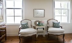 In the farmhouse's master bedroom, two French bergère chairs in a classic Louis XV style create a sweet sitting area.