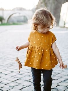 - Mustard yellow and white polka dot shirt- Empire waist and skinny jeans. Little girl style ... adorable! -