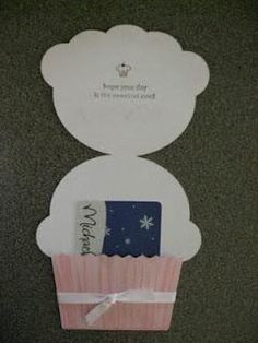 "cupcake card holder. Use one 8.5""x11"" folded hot dog style. Unfold and trace entire cupcake onto passport and cut. Fold up cupcake. Each piece of paper yields 2 finished cupcake card holders"