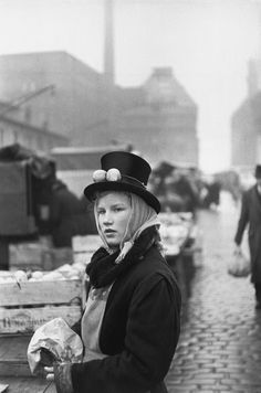 Henri Cartier-Bresson // WEST GERMANY. Hamburg. Winter 1952-1953. Fish market. Saleswoman of lemons.
