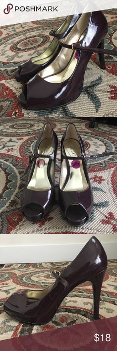 Dark purple Guess heels with strap! Shiny dark purple Guess heels with cute strap! Slight wear shown in pictures. Worn twice! Guess Shoes Heels