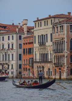 A honeymoon must! A gondola ride through the canals of Venice, Italy
