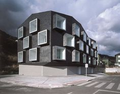 This is an example of crystallographic balance. The pattern of windows along the building creates a balance, bringing the design together.