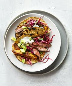 Plantains, the starchier and less sugary version of a banana, are generally green and can be found in the produce section of most grocery stores. Here, the slightly sweet potato-like texture of the plantain provides the perfect complement to the tangy cabbage slaw.