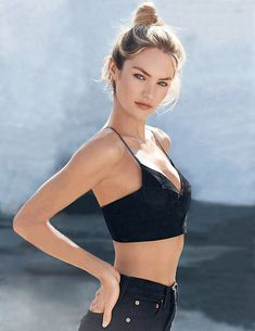 Candice Swanepoel hair bun bra top high waisted shorts