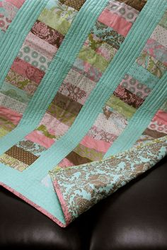 Love this quilt. I love the quilting on the long aqua strips. So pretty.
