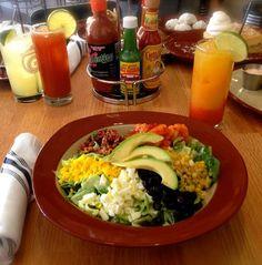 Gringo Cobb Salad made with chopped lettuce, (Coctel shrimp), avocado, boiled egg, corn, black beans, pico de gallo, crispy bacon, Cotija cheese and avocado buttermilk (ranch).