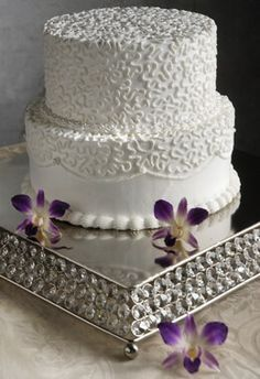80.00 SALE PRICE! Sumptuously display your wedding cake on this 14x14 Crystal & Stainless Cake Stand. This piece is 14in square at the base and 2.5in tall, a...