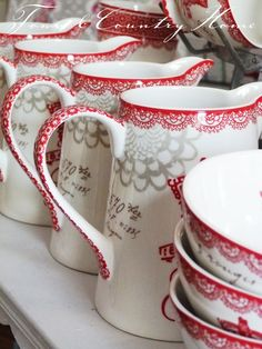 Red and white pitchers for in the red and white kitchen - open shelves in a hutch would be the perfect spot for them!