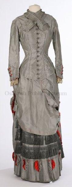 Dress: ca. 1876, American, pin-striped silk fabric, basque bodice, cut steel buttons, lace, fringe.