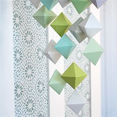 This polyhedron paper mobile is a beautiful sculptural addition to any room. Tutorial includes template and step-by-step instructions.