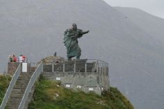 Statue of St Brendan looking out over Fenit Harbour, County Kerry, Ireland