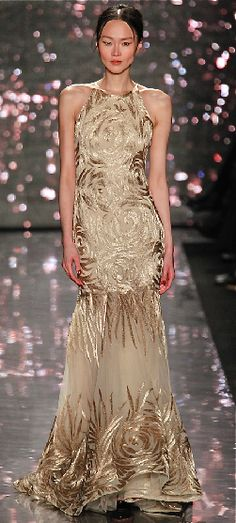 This wonderful nude gown is so effortlessly and perfectly accented with this golden, shimmering embroidered floral pattern