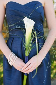 Bridesmaids carried single large calla lillies. Photo: Rebecca Arthurs Photography