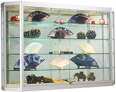 Use this large glass display case on the wall to move merchandise up to eye-level and save floor space. Crafted from durable silver anodized aluminum, this cabinet has 4 fully adjustable, 12-inch extra deep, rubber-cushioned, tempered glass shelves and a sleek angled front design. There is a... more details available at https://furniture.bestselleroutlets.com/accent-furniture/display-curio-cabinets/product-review-for-wall-mounted-silver-aluminum-glass-display-cabinet-illumina