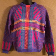 Vintage Calvin Klein Sweater size small Adorable vintage sweater. 100% wool. Beautiful bright colors! Calvin Klein. One small pick in the back. Can easily be snipped off. Size small. A loose fit. Calvin Klein Sweaters Crew & Scoop Necks