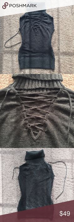 Wool black sleeveless v neck laced turtle sweater Supper chic !!! Soft on skin   Very stretchy hugs body.  nice curves. Trending v neck with long tone on tone lace for adjustable fit and styling. Cable knit side panels. New black with hint of heather grey. Very flattery. Images show colors in a different natural lighting. 3rd imaging is most true to color in a iPhone 6. Of course it may vary in different monitor/ phone.** new with flaw : a fixed small hole in the front waist area.  Hard to…