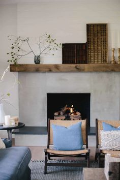 Brick Fireplace Makeover using Cement & Wood Mantle - Boxwood Ave - Update an old brick fireplace by using cement! This brick fireplace makeover completely transforms this living room! Brick Fireplace Makeover, Shiplap Fireplace, Concrete Fireplace, Fireplace Surrounds, Fireplace Mantels, Fireplace Update, Fireplace Ideas, Brick Fireplace Remodel, Stone Fireplaces