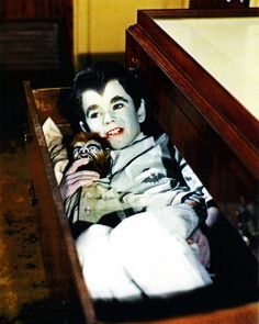 Wolfie, boy holding werewolf doll, The Munsters Butch Patrick, werewolves,