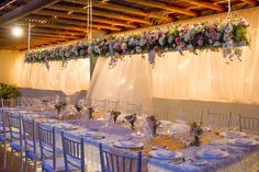 A gorgeous reception with a romantic floral theme is perfectly accentuated with low lighting #SecretsHuatulco #Mexico #DestinationWedding
