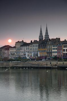 Town view of Quai Lamartine n Saone River at Sunset in Macon, Maconnais Area, Burgundy region, Saone-et-Loire_ France
