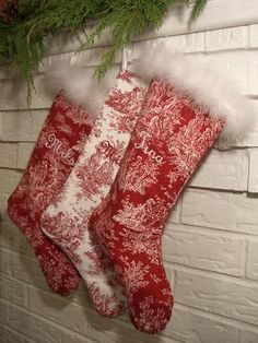 I LOVE these handmade toile stockings with feather boa trim.  Now how to embroider the names.....