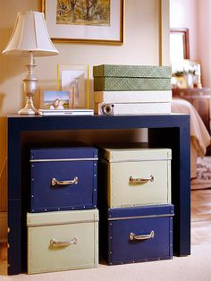 "Get serious about organizing papers    -- Dig out all the boxes of paperwork and piles of bills (both paid and unpaid) you've been hoarding and start to purge.  -- Separate items into three categories: ""toss,"" ""keep,"" and ""maybe."" Then think about storage.  -- A simple Parsons table leaves plenty of room for color-coordinated storage boxes underneath and office supplies up top"
