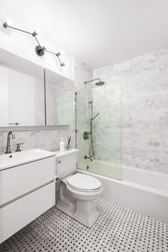 Pairing Signature Hardware's polished nickel shower fixture with light-colored tile creates an airy environment in this bathroom renovation. Mold In Bathroom, Large Bathrooms, Small Bathroom, Master Bathroom, Bathtub, Rustic Bathroom Vanities, Wood Bathroom, Washroom, Bathroom Styling
