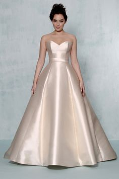 Not this dress at all. BUT the overall theme. The simplicity and the luxe material (this is Mikado silk I think?). A TO Z GOWNS   Augusta Jones 2014