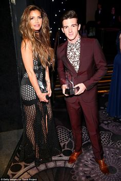 Drake Bell Photos - Actors Charisma Carpenter and Drake Bell attend the Thirst Project's Annual thirst Gala at Beverly Hills Hotel on April 2017 in Beverly Hills, California. Drake Bell, Charisma Carpenter, Photography Movies, Sheer Gown, Man Illustration, Buffy The Vampire, Sarah Michelle Gellar, About Hair, American Actress