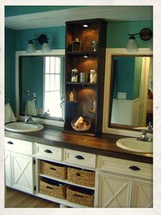 Love everything about this bathroom.  The cabinets, framed mirror, shelf in the center, and the beautiful butcher block counter top.