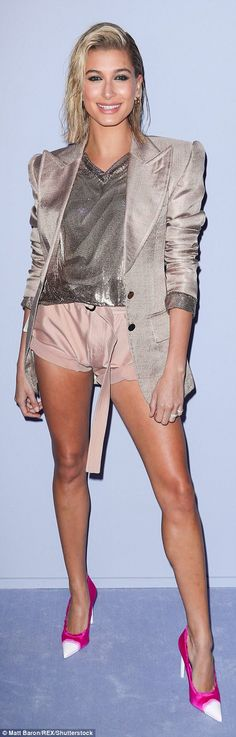 Fancy: Hailey Baldwin went for neutral shorts with a coordinating blazer for Tom Ford's Fall/Winter 2018 presentation during New York Fashion Week; Joining her was Rosie Huntington-Whiteley (r)