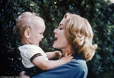 Princess Grace Kelly shares a smile with her son Albert II in 1959