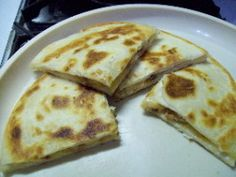 """Chicken Bacon Ranch Quesadillas- 2 9"""" tortillas are enough for a meal for the two of us. Used two medium chicken breasts, marianated in fajita mix, 8 oz cheese,  1/4 c bacon crumbles, 4 TB ranch. Cooked on pancake griddle."""