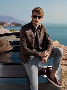 French model Baptiste Radufe is a cool vision in a brown leather jacket from Lufian.