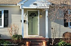 I love this front door paint color and dark hardware combination!