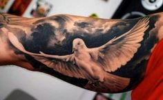 Mens Cloud Tattoo With Dove On Bicep