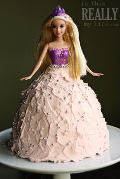 Princess Barbie doll cake recipe -- very retro but still a hit with my girls. The white cake recipe I used was delicious as was the super easy buttercream frosting. (BTW, Rapunzel absolutely LOVED her dress.) #cake #recipe